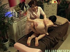 Aggressive masseuse is all over her Japanese pussy