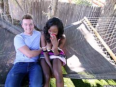 Jezabel Vessir poses in a hammock with her big natural boobs out. She shows her lovely breasts to lucky white guy. He finally grabs her lovely juicy tits. She turns him on badly!
