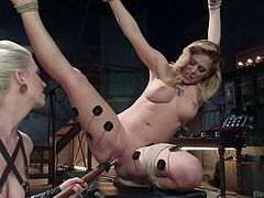Do you like when bitches use kinky sex toys? Click to watch a blonde seducing milf with fascinating tits, tied up with ropes. The helpless lady has electrodes attached to her flexible long legs and gets aroused with a vibrator. See the dominant slutty babe helping her, to get the most of the fun.