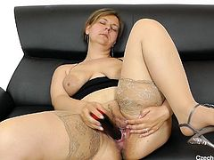 Older women need sex just as much, as young sluts do. Iva is no exception, as the horny Czech milf gets naked and on the couch, spreading her pussy wide for all to see. She gets her long black vibrator out and starts licking and sucking it, before pushing it deep inside her. Hear her moans of desire.