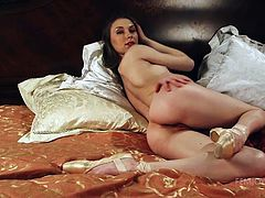 If flexible ballerinas fascinate you, see naughty Karina, completely nude and exposing her lovely buttocks. The most exciting part begins when she lays in bed, touching her natural small boobs and spreads widely her legs, to show off her peachy cunt. Enjoy the sexy details!