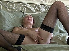 It's high time, that this slutty mature lady spends some quality time, playing dirty with herself. The blonde-haired bitch with nice tits lays in bed and spreads widely her legs, to finger and rub softly her naughty pussy. Enjoy the exciting solo moments!