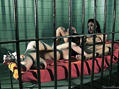 Yeah, it's pretty cliché seeing the hot lesbians in a jail cell, but that doesn't mean it's not still hot as fuck! They mack on each other's muffs like there's no tomorrow. After some more tongue in bush action, the scissoring begins, their pussies grinding together. To see more of this, click now!