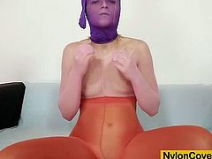 Sweet Cat loves to masturbate her shaved muff when she is fully covered in spandex silky nylons from head to toe