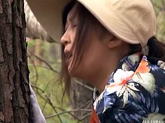 What this Japanese lady though it would be a peaceful promenade in the forest, soon become a passionate adventure, as she is persuaded into getting on knees and sucking her horny partner's cock. Watch the man pounding her from behind.