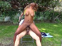 Busty dark skinned chick Tori Taylor displays her thick ass and her big natural breasts as horny white guy drills her hot pussy with his rock stiff white cock. She loves interracial humping!