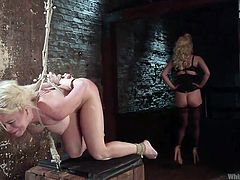 Busty Nikki has been tied up and bonded strongly with ropes, by a sensual dominant lesbian bitch. Check out the intense rim job and see the blonde babe spreading legs, to let slutty Cherry penetrate her peachy pussy with a kinky strap on.