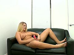 Naked natural buxom blonde Katie Banks exposes her big nice titties as she toy fucks her wet snatch on the couch in the casting room for a lucky dude to watch. He touches her boobs as she masturbates.