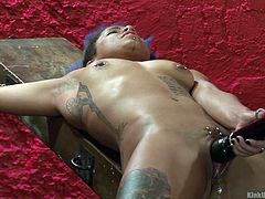 This cutie is tied up on the stocks and pleasures herself with her vibrator. While she masturbates, her mistress comes in, to torture her with some tickling. The black slave has her feet rubbed and tickled. How much can she handle before she has to stop?
