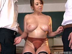 This teacher gets all oiled up and pulls out her massive boobs, so two of her students can get turned on and have some naughty fun with her. The schoolboys lick her nipples and finger her twat so deeply.