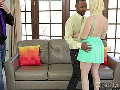 Horny blonde wife can't get enough from her incompetent husband. So she finds herself a big black sex machine, attached to the wild man Tee, and gets down and dirty in front of her husband. See how this black man enjoys the hot busty body of Nikki, and licks her pussy juice nicely, before ramming her hard and deep!