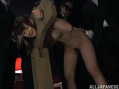 Hundreds of years ago, the stocks were a form of public punishment. Now, they're used for kinky sex, like the scene here. Yukiko is locked in the stocks and is getting cocks. She gets one shoved in her mouth and another in her pussy from behind. She sucks and takes the pounding like a good whore.