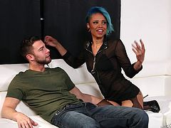 Slutty Jessica is confident in her power of seduction. Click to see the ebony babe with short blue-dyed hair, taking off her clothes, to show her tattooes to the guy resting on the couch. Watch this slut removing her bra with sensual movements and sucking dick.