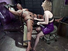 Are you wondering what the blonde mistress is up to now? The blonde babe is going to please her beautiful ebony slave in ways she has never though about. Click to see electrodes attached to Lisa's soft skin, as Cherry keeps fingering pussy. Using an electric wand will do the trick... See the details!