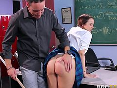 It's not hard to notice the hot babe in kinky uniform, sitting in the back of the classroom, as she keeps fingering her appetizing cunt, while the teacher is writing on the board. See the bitch's ass spanked well... The busty slut with pigtails is eager to get on knees and suck cock. Have fun!