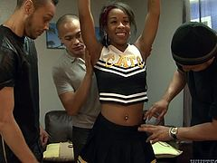 A hot cheeleader with chocolate skin and tattooes feels great in the company of three horny guys, who are eager to take off her sexy uniform, and check out her tits and incredible ass. They seem very pleased with what they discover... See the lusty ebony bitch sucking cocks!