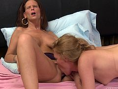 Syren sticks her head in between the legs of her sexy blonde girlfriend and performs the best cunnilingus you have ever witnessed. Her sex partner Daisy returns the favor and uses her tongue to stimulate that sweet clitoris.