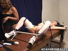 Asian hottie has a gag ball in her mouth and a spreader on her ankles so she has no choice BUT to take the toy stimulation between her legs. Domina is a proper hottie.
