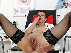 Rozi loves her job, but sometimes it just gets to her. In times such as these, she strips down to nothing and lets her big boobs hang. She then stretches her legs apart, to open up her pussy hole. It is pretty big and can easily take her fingers in. She feels the inside of her vagina and stretches it wide, to please herself.