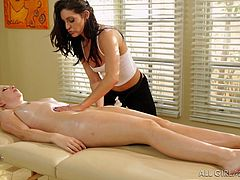 Besides providing a relaxing massage, slutty Gracie is eager to offer other services, too. Click to watch her oiling a blonde babe's nude body. The atmosphere spices up, when she also begins to eat that peachy shaved cunt. Enjoy!