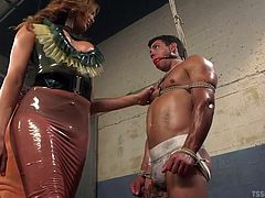 In the sex dungeon this male slave is treated horrible by his shemale mistress. The goddess sticks her ass in his face. He has to take a big whiff, before having his pretty little mouth fucked hard by her massive tranny penis.