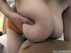 This fat older Japanese woman takes off her clothes, to reveal a huge pair of natural tits. She teases her young boyfriend, as she rests her huge jugs on his chest. The beauty has her gigantic, fat breasts oiled up and rubbed.