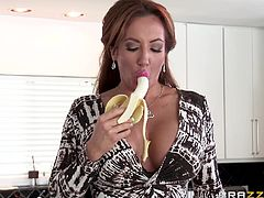 Slutty Richelle looks so hot while peeling a banana and lasciviously touching her wonderful big boobs. Click to watch the lusty milf spreading legs and getting really dirty in the kitchen. Don't miss the very steamy pussy eating scene!