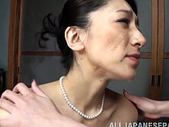 This hot couple enjoy some hardcore sex with a nice big black strap on. One of the lovely Japanese women shoves the fake cock deep into her lover's cunt and rams her hard from behind. She moans with pleasure.
