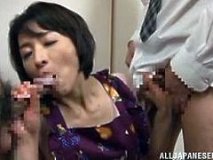 Well, if you didn't already know that the Japanese are sex maniacs, you'll know it from this scene! Hisae isn't a blonde American slut, but she's horny enough that two dicks are needed to quench her carnal thirst. She takes both guys on eagerly, sucking them and bending over, offering her snatch to them.