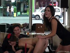 All the clients turn their heads, as the atmosphere gets really inciting in a local bar. Lullu is naked and obliged by a brunette hot bitch to suck a guy's dick. See the slutty babe entertaining the horny men at her table. Enjoy the kinky scenario!