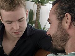 A muscled tattooed brunette man, wearing a sexy beard, expresses his lustful thoughts to slutty Gabriel. The men begin to undress. The naughty English boy is eager to taste his friend's Jessy, appetizing cock. Click to see all the dirty details. Enjoy the kinky gay rim job scene!