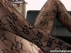 Classy brunette in a black clotchless pantyhose pisses and licks her urine