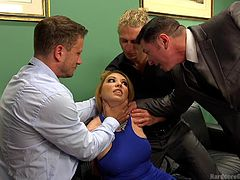 Kiki doesn't know yet, what the horny guys are up to. So, when they drag her on the floor, ripping her blue molded dress, she seems a little surpised. Click to see the busty milf with blonde hair on knees, while the men stuff their cocks down her throat...
