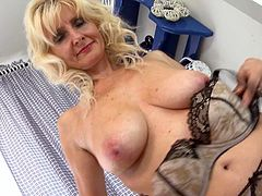 Mature lady in a blue dress strips naked and masturbates