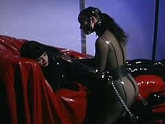 Latex Mistress works her slave
