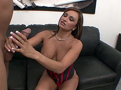Claudia Valentine wears a corset as she strokes his big dick