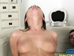 Brunette Tina Blade shows off her assets while giving tugjob