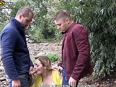 Olivia was picked up by these two horny guys. The men took her out to the woods for some sex in the great outdoors. She didn't take much convincing and soon, she was firmly grabbing their hard cocks, and deepthroating them.