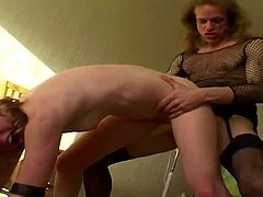 Kinky wife toys her crossdressing husbands ass with a dildo