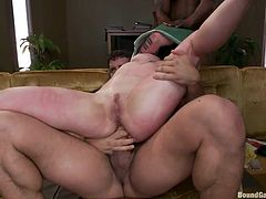Slutty Vivienne gets in trouble, when she finds alone with a gang of angry men. Click to watch the naked tattooed brunette, getting terribly mouth fucked. The horny guys cover her head with a basket, while she's getting double penetrated on the couch. Enjoy the spicy hardcore details!