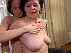 Sexy old mature licks girl pussy on the table