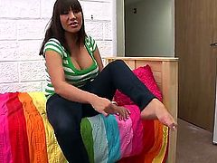 Ava Devine is a brunette milf with large tits. They are bouncing around as she is using her feet to jack off a guy. He is turned on by her sexy work.