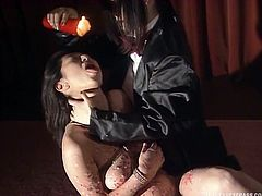 The hot wax makes her squirm and puts her in extreme pain. The master lets it drip all over her tits and stomach. He even makes her taste it. How degrading and humiliating, but she loves how it makes her feel.