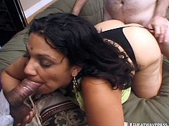 Slutty Parveen loves to get fucked by as many men as possible. She is a hot Indian milf, who truly knows how to suck a dick. John is totally impressed by her big boobs and a voluptuous figure. He makes her swallow his dick and suck it really hard. He then shoves his cock into her big pussy from behind.