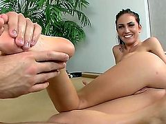 Emmanuelle London is a sweet babe that is giving a footsie to a guy that is filming her. She has a lovely ass and she does not mind exposing it to us.