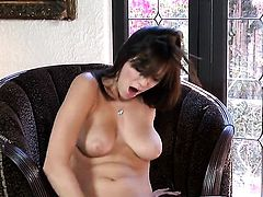 Holly Michaels with juicy breasts and shaved beaver satisfies her sexual needs alone in solo action