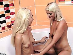 Blonde Jessie Jazz with huge breasts satisfies her lesbian needs and desires with Victoria Puppy