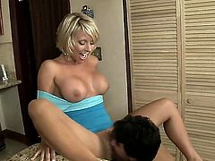 Blonde milf is shaking her ass. She is also giving a blow job in this scene. Her mouth work is really pro and she gets the guy to cum in her face, just the way she likes it.