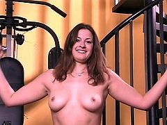 Tall slut with perky tits and tattoo works out and dildos her shaved young cunt