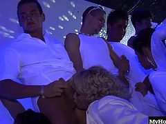 all wearing white, to indulge in a wild party filled with horny men who have blondes, redheads and brunettes lining up for an opportunity to grab their stiff meat poles and suck till they feel a throbbing sensation, letting them know that a warm facial cumshot on its way.